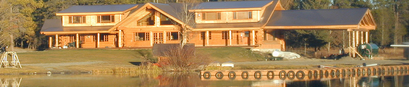 Header Photo of the lodge, several cabins and the lawn